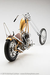"""""""Gold Dust Woman"""", A 40over springer chopper, built from a '52 Panhead, by Clinton Wallace of Cleveland Texas. Photographed by Michael Lichter in Sturgis, SD on 8/10/2018. ©2018 Michael Lichter."""