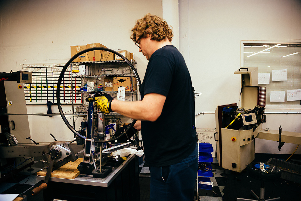 Building wheels in the Santa Cruz bicycle factory.