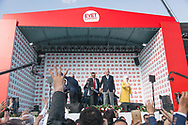 Turkish President Recep Tayyip Erdogan gives gift to the large crowds at an AKP rally in Izmir, Turkey, supporting a 'YES' vote in the upcoming constitutional referendum.