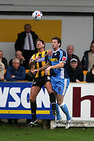 Photo: Pete Lorence.<br />Boston United v Wycombe Wanderers. Coca Cola League 2. 28/10/2006.<br />Boston's Drewe Broughton (L) and Mike Williamson in mid air action.