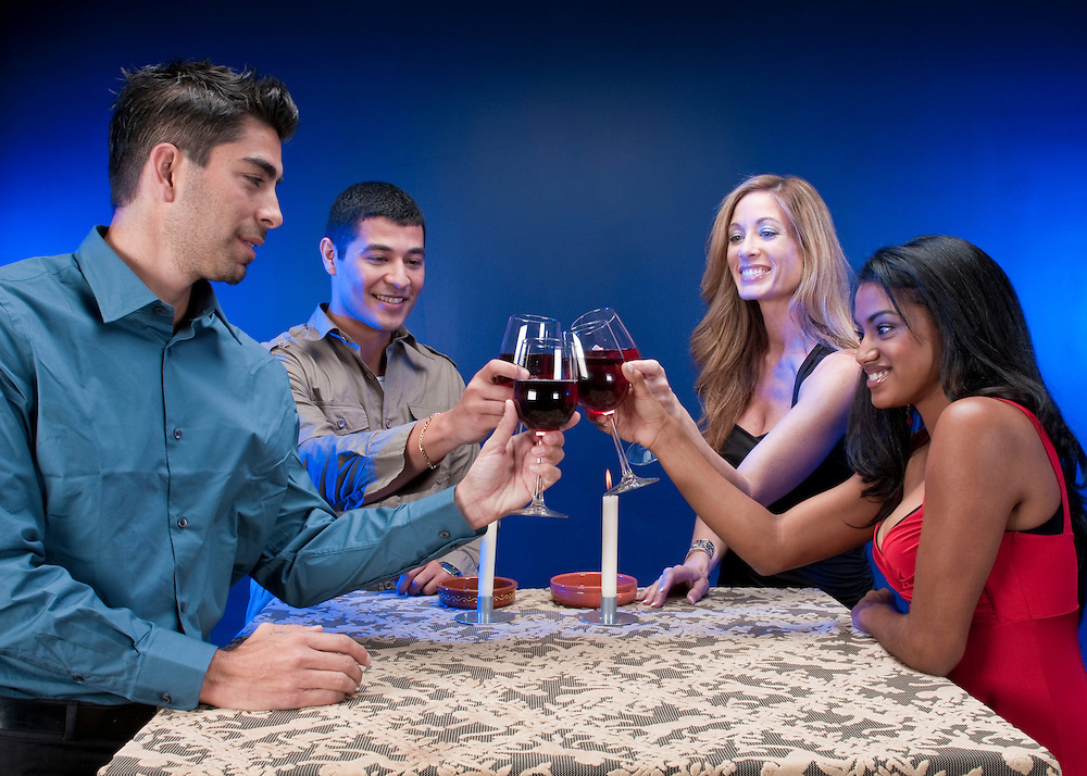 Group of multiracial friends toasting and celebrating.
