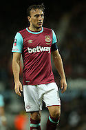 Mark Noble of West Ham United looks on. The Emirates FA cup, 6th round replay match, West Ham Utd v Manchester Utd at the Boleyn Ground, Upton Park  in London on Wednesday 13th April 2016.<br /> pic by John Patrick Fletcher, Andrew Orchard sports photography.