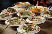 dishes of hummus with various toppings usually served with pita as a mezze in middle eastern restaurants in Israel