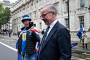 Pro remain campaigner Steve Bray interviews Michael Gove MP, Chancellor of the Duchy of Lancaster as he leaves the Cabinet office in London, United Kingdom on 16th August 2019.