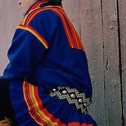 Sami reindeer herder dressed in Gakti, traditional dress, Lapland, Sweden