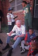 Jimmy Carter goes door to door in an Atlanta neighborhood, urging parents to have their children vaccinated.