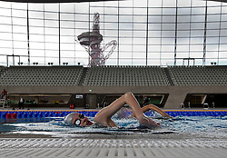 © Licensed to London News Pictures.25/02/2014.LONDON UK. <br /> Local School Children get a chance to be one of the first to swim in the Olympic Swimming Pool at the London Aquatic Centre, as the former Olympic venue prepares to open it doors to the public this weekend.<br /> Photo credit : Andrew Baker/LNP