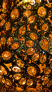 Close-up of vase made from linked orange glass gems and metal pieces, inside a temple, Tao Dan Park, Ho Chi Minh City, Vietnam, Southeast Asia