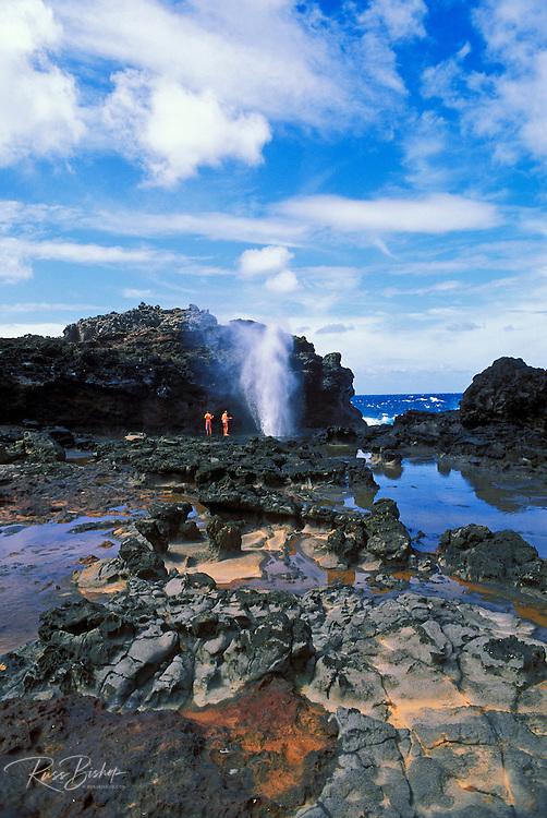 Kids enjoying the action at the Nakalele Blowhole on the West Maui coastline, Maui, Hawaii