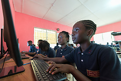 4 November 2019, Vriginia, Liberia: 12-year-old Sodah Sackor (right) and 12-year-old Vickey V. Wion (left) study in the computer lab at Ricks Institute. The Liberia Baptist Convention runs Ricks Institute, a day and boarding school for currently 496 students from kindergarten up through 12th grade.