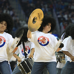 28 January 2009:  A member of the New Orleans Bucs drumline performs during a 94-81 win by the New Orleans Hornets over the Denver Nuggets at the New Orleans Arena in New Orleans, LA. The Hornets wore special throwback uniforms of the former ABA franchise the New Orleans Buccaneers for the game as they honored the Bucs franchise as a part of the NBA's Hardwood Classics series. .
