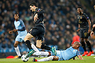 Manchester City's Fernando (6) gets the tackle on Celtic's Tomas Rogic (18) during the Champions League match between Manchester City and Celtic at the Etihad Stadium, Manchester, England on 6 December 2016. Photo by Craig Galloway.