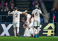 Football - 2018 / 2019 Premier League - Crystal Palace vs. Manchester United<br /> <br /> Manchester United players celebrate with Romelu Lukaku (Manchester United) after he scores his second goal of the evening at Selhurst Park.<br /> <br /> COLORSPORT/DANIEL BEARHAM