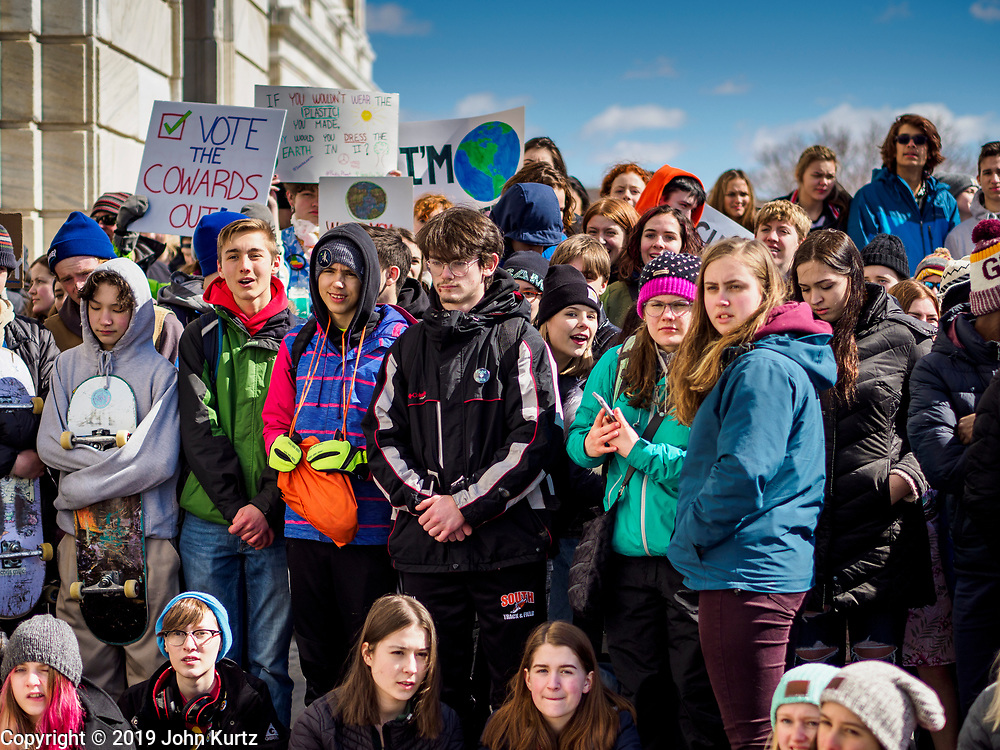 """15 MARCH 2019 - ST. PAUL, MINNESOTA, USA: Minnesota high school students gather on the steps of the state capitol during the MN Youth for Climate Justice """"Climate Strike"""" at the Minnesota State Capitol in St. Paul, MN. Thousands of high school students braved below freezing temperatures and biting winds to demand action on climate change. The Minnesota Climate Strike was inspired by the strike by Greta Thunberg, a Swedish high school student, who started a climate strike at her school in August 2018.       PHOTO BY JACK KURTZ"""