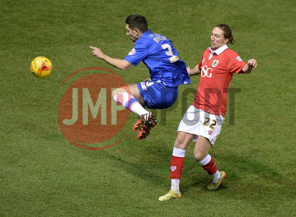 Bristol City's Luke Ayling tackles Gillingham's Joe Martin - Photo mandatory by-line: Alex James/JMP - Mobile: 07966 386802 - 29/01/2015 - SPORT - Football - Bristol - Ashton Gate - Bristol City v Gillingham - Johnstone Paint Trophy Southern area final