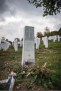 """Rudolf Hren was killed in 1995, though it wasn't until 2010 that his body was found and exhumed from a mass grave in the Bosnian countryside. Hren was one of about 8,000 people, almost all of them men and boys, slaughtered over several days that July by Bosnian Serbs around Srebrenica, the worst atrocity in Europe since World War II. Except for four Catholics, all those killed were Muslim, and most of the dead are now buried at the Srebrenica-Potočari Memorial and Cemetery, which is nestled in hills that remind me of east Tennessee.<br /> <br /> Hren's is the only Christian (Catholic) grave in the cemetery. He grew up and lived in Srebrenica with his Muslim neighbors. After his body was identified and the decision needed to be made about where to bury him, his mother Barbara said, """"He was with them, he died with them. He should rest with them, too."""" Hren's wife Hatidža and daughter Dijana agreed.<br /> <br /> I spent several hours in this cemetery over two days. I watched women visit the graves of their husbands. I saw one man wander throughout the cemetery, visiting headstone after headstone and praying at each, hurt still in his eyes. Watching him was heartbreaking, and I assumed that each stop was someone important to him — a friend, a neighbor, a loved one — and that he had spent the last 18 years without them because people, some with crosses tattooed on their arms or chest, had slaughtered them.<br /> <br /> And so I was thankful for Rudolf Hren and his family, that by being one of the slaughtered, and by choosing to be buried here, a cross would not just be associated with those who did the killing. It would also be identified with someone who shared in the suffering.<br /> <br /> http://www.rferl.org/a/27114531.html"""