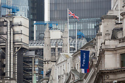 The flags of the Russian Federation and Russian investment Bank VTB Capital hang over banks and other financial institutions in the City of London, the capital's financial district (aka The Square Mile), on 26th March, 2018, in London, England.  VTB Capital operates in London, Singapore, Hong Kong, Sofia, New York, Zug and Frankfurt, with headquarters in Moscow, VTB Group's Corporate Investment Business is a leader in the international investment banking sector in Russia. VTB Bank is one of the leading universal banks of Russia. VTB Bank and its subsidiaries form a leading Russian financial group – VTB Group, offering a wide range of banking services and products in Russia, CIS, Europe, Asia, Africa, and the U.S. The Group's largest subsidiaries in Russia is the Bank of Moscow.