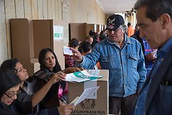 Kolumbien - Friedensvertrag mit der Farc scheitert im Referendum / 021016Bogota, Cundinamarca, Colombia - 02.10.2016        <br /> <br /> <br /> *** Polling station of the Colombian peace contract referendum at  Palza de Bolivar in Bogota. The Colombian citizens voting if the peace treaty negotiated between the government and the left FARC guerrilla becomes valid. The FARC has been in war with the Colombian government for 52 years<br /> ***