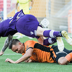 BRISBANE, AUSTRALIA - OCTOBER 30: Jade North of the roar tackles Andy Keogh of the Glory during the round 4 Hyundai A-League match between the Brisbane Roar and Perth Glory at Suncorp Stadium on October 30, 2016 in Brisbane, Australia. (Photo by Patrick Kearney/Brisbane Roar)