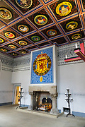 The King's Inner Hall at Stirling Castle, with ceiling of 37 carved replica Stirling Heads, originally designed for James V and finished by his widow Mary of Guise in the 1540s. Once the capital of Scotland, Stirling is visually dominated by Stirling Castle, in the United Kingdom, Europe. Historically, Stirling controlled a strategic position (until the 1890s) as the lowest bridging point of the River Forth before it broadens towards the Firth of Forth, making it the gateway to the Scottish Highlands. One of the principal royal strongholds of the Kingdom of Scotland, Stirling was created a royal burgh by King David I in 1130. Stirling Castle sits atop Castle Hill, an intrusive crag, which forms part of the Stirling Sill geological formation. Most of the stronghold's main buildings date from the 1400s and 1500s, when it peaked in importance. The outer defences fronting the town date from the early 1700s. Before the union with England, Stirling Castle was also one of the most used of the many Scottish royal residences, serving as both a palace and a fortress. Several Scottish Kings and Queens have been crowned at Stirling, including Mary, Queen of Scots in 1542, and others were born or died there. Stirling Castle has suffered at least eight sieges, including several during the Wars of Scottish Independence, with the last being in 1746, when Bonnie Prince Charlie unsuccessfully tried to take the castle.