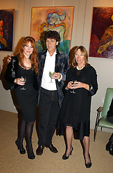 Left to right, MISS CHARLOTTE TILBURY and her parents, artist LANCE TILBURY and PATSY TILBURY at an exhibition of recent work by artist Lance Tilbury held at the Old Imperial Laundry, Warriner Gardens, Battersea, London on 7th December 2004.<br /><br />NON EXCLUSIVE - WORLD RIGHTS