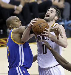 June 7, 2017 - Cleveland, OH, USA - The Cleveland Cavaliers' Kevin Love (0) is fouled inside during the second quarter by the Golden State Warriors' David West in Game 3 of the NBA Finals on Wednesday, June 7, 2017, at Quicken Loans Arena in Cleveland. (Credit Image: © Phil Masturzo/TNS via ZUMA Wire)