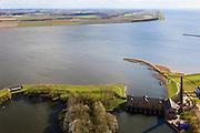 Nederland, Friesland, Gemeente Lemsterland, 16-04-2012; Lemmer, ir. D.F. Woudagemaal. In de achtergrond de Noordoostpolder (NOP). Het stoomgemaal staat op de Unesco Werelderfgoedlijst en is het grootste nog in bedrijf zijnde stoomgemaal ter wereld. Bij extreem hoge waterstand doet het gemaal nog dienst en helpt om de waterstand van het Friese boezem op peil te houden. Sinds 1967 is het gemaal oliegestookt. ..Lemmer, ir D.F. Woudagemaal. The steam pumping station features on the UNESCO World Heritage List and is the largest pumping station still in operation worldwide. At extreme high water, the station is still in service and helps to maintain the proper water level of the Friesian boezemwater. Since 1967, the pumping station is oil fired..luchtfoto (toeslag), aerial photo (additional fee required).foto/photo Siebe Swart