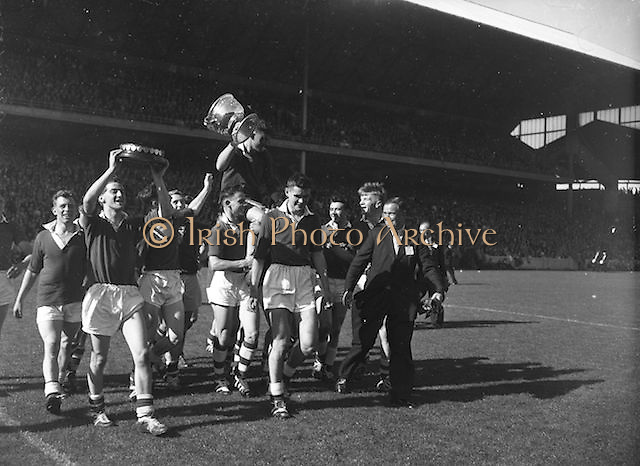 Players celebrating winning cup at the All Ireland Minor Gaelic Football Final Cork v. Mayo in Croke Park on the 24th September 1961.