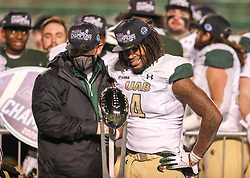 Dec 18, 2020; Huntington, West Virginia, USA; UAB Blazers head coach Bill Clark and UAB Blazers running back Spencer Brown (4) celebrate winning the Conference USA Championship after defeating the Marshall Thundering Herd at Joan C. Edwards Stadium. Mandatory Credit: Ben Queen-USA TODAY Sports