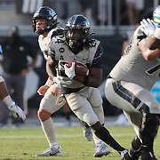 ORLANDO, FL - OCTOBER 24:  Running back Bentavious Thompson #24 of the Central Florida Knights runs against the Tulane Green Wave defense at Bounce House-FBC Mortgage Field on October 24, 2020 in Orlando, Florida. (Photo by Alex Menendez/Getty Images) *** Local Caption *** Bentavious Thompson