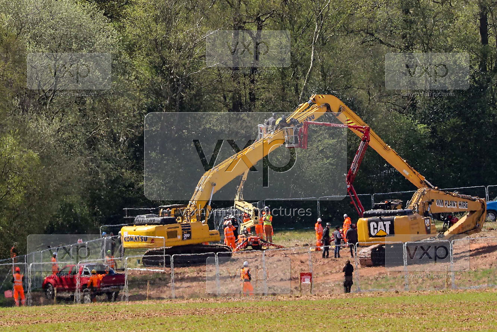 """Bailiffs and Police are seen gathered around a tree cutting truck in Crackley Woods HS2 site to remove an environmental activist who climbed the machine's cutting hand in an attempt to prevent them from cutting the ancient woods on Wednesday, April 15, 2020. (Photo/Vudi Xhymshiti)<br /> One of the biggest arguments against HS2 is around how it might impact on the country's green spaces and countryside. The Wildlife Trust claimed in a recent report that """"the deep cut HS2 will make across the landscape could stop nature's recovery in its tracks."""""""