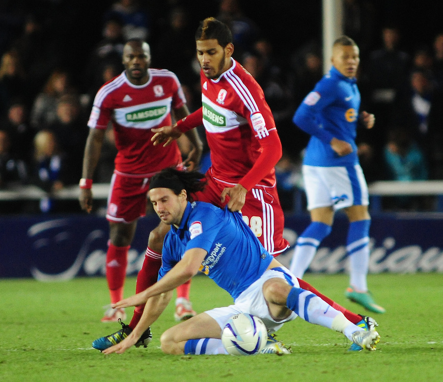 Peterborough United's George Boyd is fouled by Middlesbrough's Faris Haroun ..Football - npower Football League Championship - Peterborough United v Middlesbrough - Saturday 8th December 2012 - London Road - Peterborough..