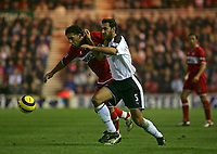 Photo: Andrew Unwin.<br /> Middlesbrough v Fulham. The Barclays Premiership.<br /> 20/11/2005.<br /> Middlesbrough's Fabio Rochemback (L) tries to get away from Fulham's Sylvain Legwinski (R).