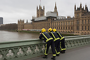 Firefighters with the London Fire Brigade use a heat-seeking camera, looking down into the River Thames waters to search for a person who jumped off Westminster Bridge, on 29th March 2017, in London, England.
