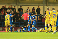 RED CARD Players lie injured after the challenge by Magnus Norman during the EFL Sky Bet League 1 match between Rochdale and Bristol Rovers at Spotland, Rochdale, England on 2 October 2018.