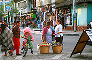 ECUADOR, HIGHLANDS, BANOS hot springs resort and street vendors