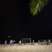 Locals play football at night time under floodlight on the beach at Ipanema beach, Rio de Janeiro, Brazil. 10th July 2010. Photo Tim Clayton...