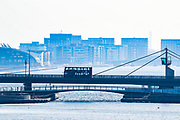 A red bus is seen driving over a Bridge near London City airport, a view taken from the Excell Center in London, Thursday, March 26, 2020. All flights from London City Airport have been cancelled as a result of the coronavirus outbreak since last night.<br /> The British Government announced Tuesday, that the ExCel Center in east London will become a 4,000-bed temporary hospital to deal with future coronavirus patients, to be called NHS Nightingale. (Photo/Vudi Xhymshiti)