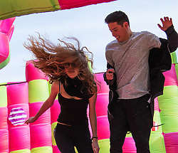More London Place, London, March 3rd 2016. PICTURED: UCL students Emma Pujol-Hodge and Diego Ospina enjoy the exuberance of the bouncy castle.<br /> A jelly-themed, adults-only bouncy castle which has been created to celebrate the launch of Candy Crush Jelly Saga, opens on London's Southbank. The multi-sensory bouncy castle especially designed for grown-ups,  marks the latest instalment of the new mobile game, Candy Crush Jelly Saga. The bouncy castle brings to life elements of the jelly-themed game and will be open to the public for free. The castle, which appears to be made up of cubes of lime and raspberry jelly, will encompass a range of multi-sensory elements, emitting fragrant, raspberry jelly-scented clouds from within its walls and making noises from the game when jumpers bounce on certain candy squares. It will also replicate the game's new competitive element and introduce visitors to Candy Crush Jelly Saga's latest character, the Jelly Queen.