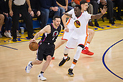Golden State Warriors forward Draymond Green (23) defends LA Clippers guard J.J. Redick (4) during the first quarter at Oracle Arena in Oakland, Calif., on January 28, 2017. (Stan Olszewski/Special to S.F. Examiner)
