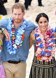 Prince Harry Duke of Sussex and Meghan Duchess of Sussex visit South Bondi Beach in Sydney where they met local surfing community group OneWave, raising awareness of mental health and wellbeing before going on a public walkabout . Photo credit should read: Doug Peters/EMPICS