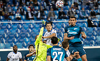 SAINT-PETERSBURG, RUSSIA - OCTOBER 20: Dejan Lovren of Zenit St Petersburg challenges for a header as Ethan Horvath of Club Brugge KV punches the ball away during the UEFA Champions League Group F match between Zenit St Petersburg and Club Brugge KV at Gazprom Arena on October 20, 2020 in Saint-Petersburg, Russia [Photo by MB Media]