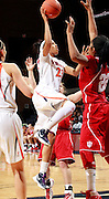 CHARLOTTESVILLE, VA- December 1: Ataira Franklin #23 of the Virginia Cavaliers shoots the ball over Sasha Chaplin #22 of the Indiana Hoosiers during the game on December 1, 2011 at the John Paul Jones Arena in Charlottesville, Virginia. Virginia defeated Indiana 65-49. (Photo by Andrew Shurtleff/Getty Images) *** Local Caption *** Ataira Franklin