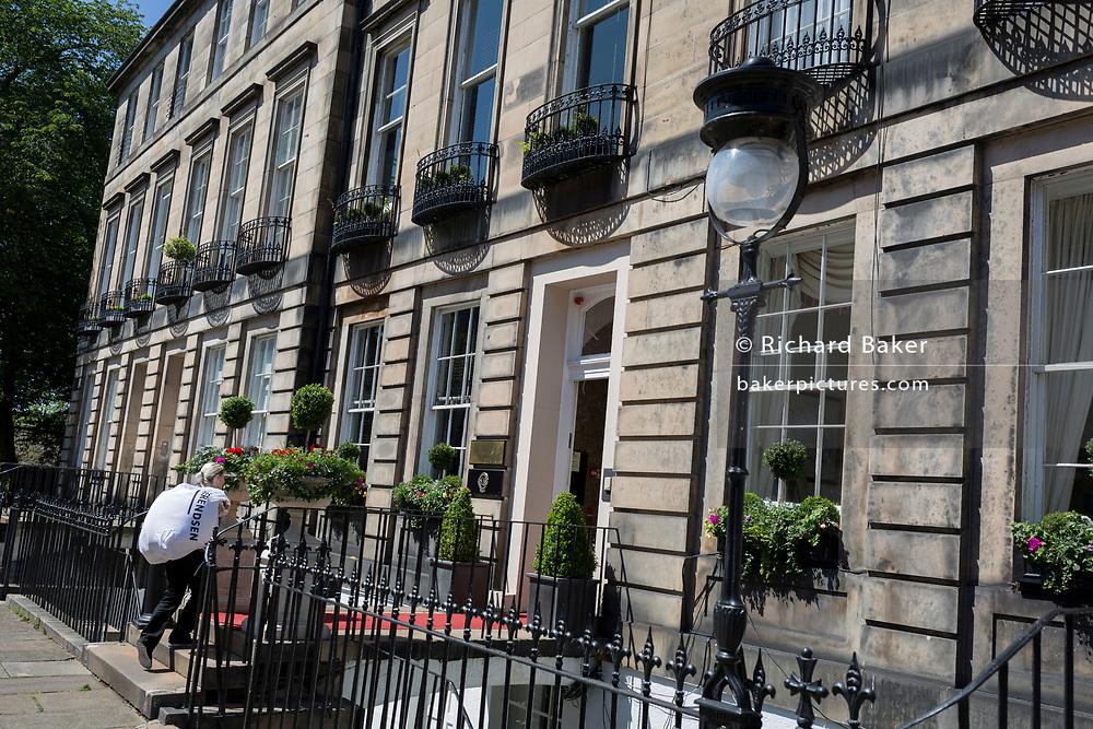 Housing architecture plus ironwork balconies and street lighting  on Gloucester Terrace in Edinburgh, on 26th June 2019, in Edinburgh, Scotland.