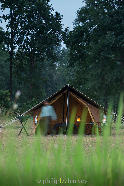 View of man standing in front of vintage style camping, Rani Pani Safari Lodge, Sohagpur, Madhya Pradesh, India