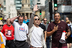 """Protesters march towards the BBC from Oxford Circus as several hundred protesters in London in central London demand the release of """"political prisoner"""" right wing talisman Stephen Yaxley-Lennon  - also known as Tommy Robinson, who was imprisoned for contempt of court. London, August 03 2019."""