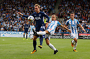 Christian Eriksen of Tottenham is tackled by Huddersfield Town's Chris Löwe during the Premier League match between Huddersfield Town and Tottenham Hotspur at the John Smiths Stadium, Huddersfield, England on 30 September 2017. Photo by Paul Thompson.