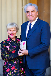 Actor Jim Carter, together with his wife actress Imelda Staunton proudly displays his OBE following an investiture ceremony at Buckingham Palace in London. London, March 14 2019.