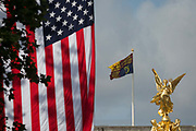 On US President Donald Trumps first day of a controversial three-day state visit to the UK by the 45th American President, The US Stars and Stripes flag hangs next to the Royal Standard flag on the roof of Buckingham Palace, on 3rd June 2019, in London England.