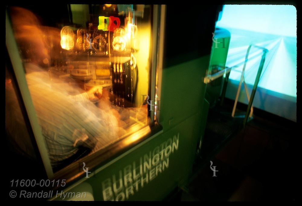Full-motion locomotive simulator shakes as video of tracks plays; Natl Acdmy RR Sciences/KC Kansas